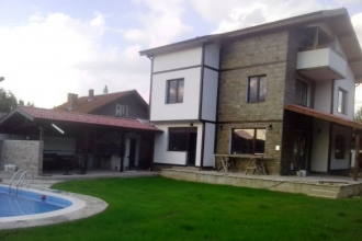 Newly built three storey house with a pool in the village of Shemshevo